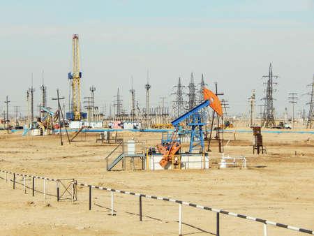 oilrig: Oil rocking chair on the field. Zhanaozen. Kazakhstan.