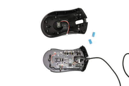 dismantle: Dismantled computer mouse. Isolated on white background.