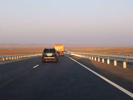 Overtaking on the track. Mangistau region. Kazakhstan.