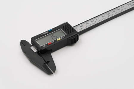 Electronic digital caliper. On a white background.