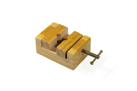 Small wooden vise. Close-up. Isolated on white background. Archivio Fotografico