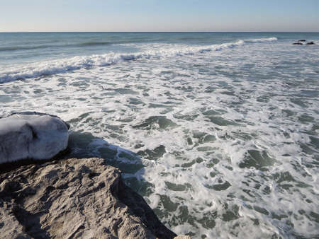 Rocky winter coast of the Caspian Sea. 스톡 콘텐츠