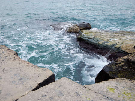 Rocky shore of the Caspian Sea. The month of February. Stock fotó