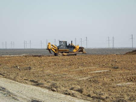 Bulldozer in the desert. Laying a new road. Kazakhstan.