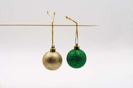 Gold and green ball on a stick. Stock Photo
