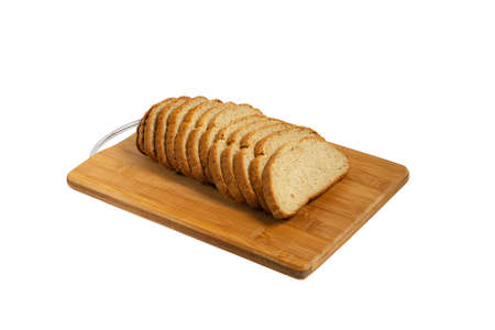 Sliced bread on a board. Close-up. Isolated on white background.
