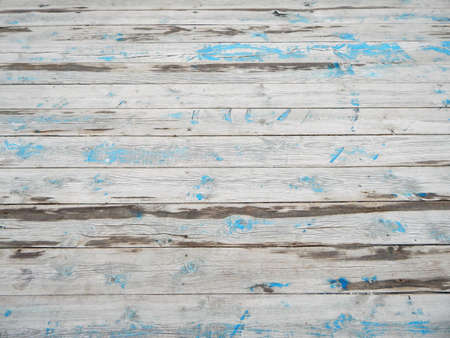 Texture of old floorboards with traces of paint.