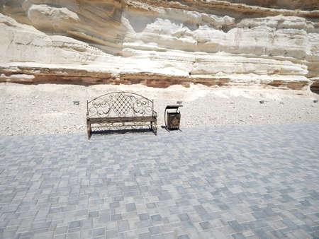 Forged bench and litter bin. Chalk rock strata. Cape Cretaceous Aktau. City by the sea. Mangistau. Aktau. Kazakhstan.