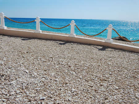 Decorative rack fence with a rope. Coast of the Caspian Sea. Aktau. Kazakhstan.