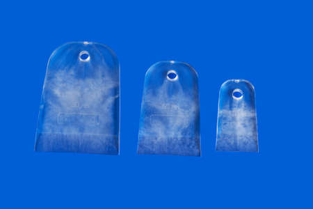 Set of transparent silicone spatulas. Close-up on a blue background.