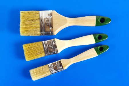 Paint Brush Set. Close-up on a blue background.