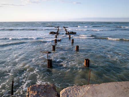 Old concrete pier Caspian Sea. Kazakhstan. Mangistau region. Aktau city. 05 November 2019 year. Stock Photo