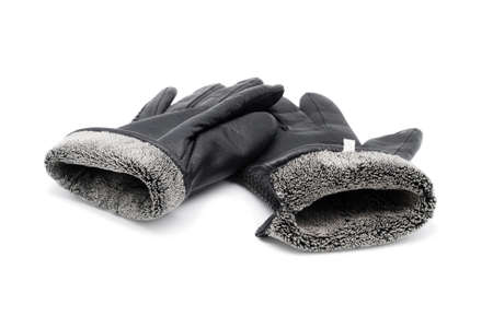 Leather black gloves. Close-up. Isolated over white background. Stock Photo