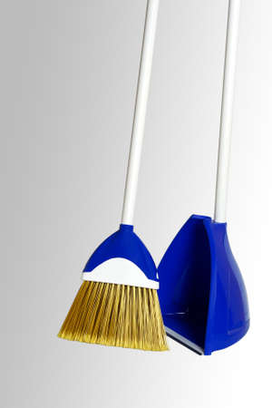 Broom with dustpan set. Close-up. Isolated on a gray background.