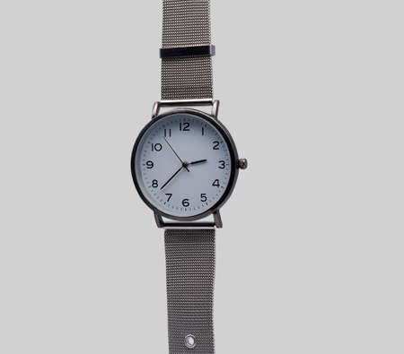 Wristwatch with a metal strap. Close-up. Isolated on a gray background. Stock Photo