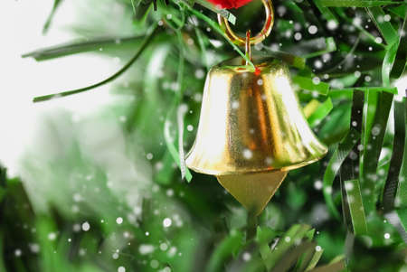 jingle: Jingle bell hanging from Christmas tree with spreading snow.
