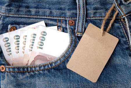 wildwest: worn blue jeans with money Stock Photo