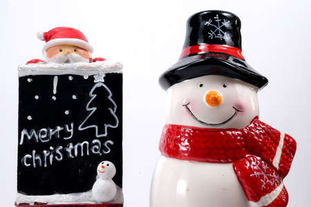 merry christmas: merry christmas board and snowman doll on white background