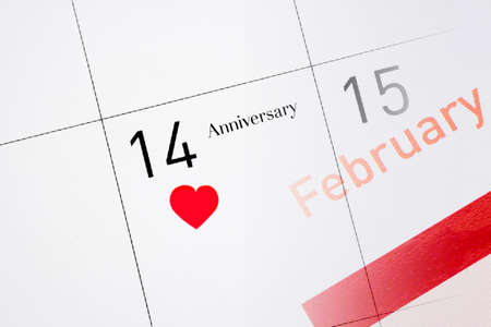 saint valentines: Calendar page with the red heart on February 14 of Saint Valentines day. Stock Photo