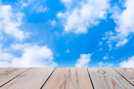 empty room background: Wooden terrace on blue sky background