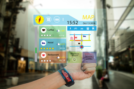 ar: iot, internet of things,concept man use smart watch with augmented reality technology to show the map, recommended place with review including like,ratio of vote,and transport vehicle,while travel