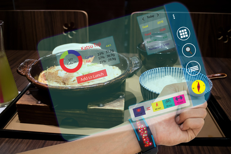 iot,internet of things, smart watch concepts,man use augmented reality to calculate food intake and calories while have a food,the data compare the meal with run, biking,and weight  training