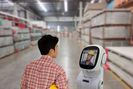 engineer use robot advisor technology to talk with boss or team mate for consult at store site to improve a work ,a futuristic robot help a work to easy