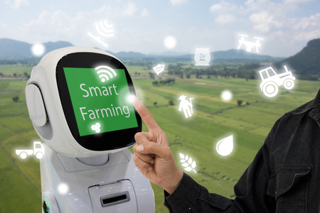 iot, internet of things, agriculture concept, Farmer use smart robot to help to control monitor and management including feed water, fertilizer, chemical, replant etc in the farm for more efficiency