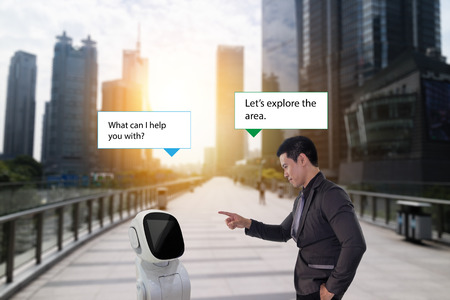 robot advisor, business man talk with a high technology robot assistant (AI or artificial intelligence) how to help him while he on the walk way with a beautiful cityscape with fake sunlight