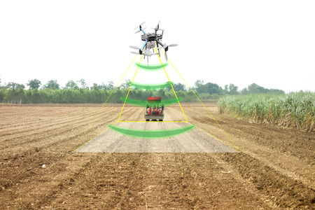 iot, internet of thins, agriculture concept, Farmer use drone to send a signal to detect and monitor the area while the tractor working in the farm with augmented reality technology