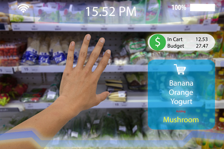 internet of things, iot,man hand try to pick the product in to the cart with augmented reality technology with virtual reality display screen which show the product and subtotal in the retail or store