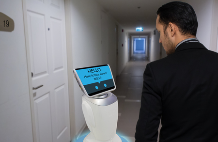 robot in hotel concept, robotic butler help the customer to the room that booking, put the object, food, accessories inside it.