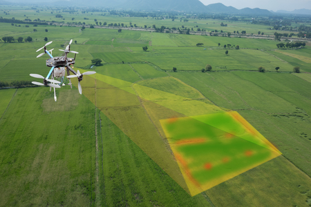 drone for agriculture, drone use for various fields like research analysis, safety,rescue, terrain scanning technology, monitoring soil hydration ,yield problem and send data to smart farmer on tablet Stock Photo