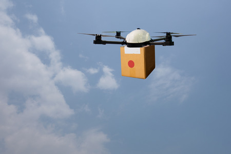 device: drone flying transportation in smart city concept, a retailownder use a drone(artificial intelligence technology delivery to send a tool kit, product, fruit, vegetable, etc in the store,  to customer Stock Photo