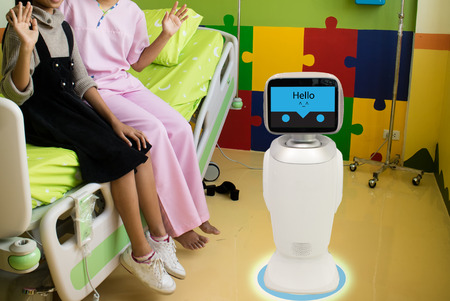 robot service in medical talk with the patient at patient room in hospital l and it caretakers can interact with their patient check on their living conditions and the need for further appointments