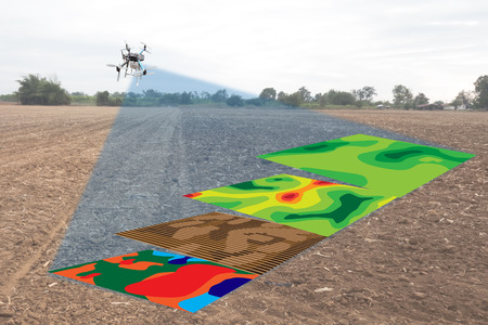 smart agriculture concept, farmer use infrared in drone with high definition soil mapping while planting,conduct deep soil scan during a tillage pass include organic, ec, om, Nitrogen,seed rate 스톡 콘텐츠