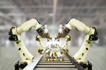 iot industry 4.0 technology concept.Smart factory using trending automation robotic arms with empty conveyor belt in operation line. Automotive manufacturing use it for precision, Repetition, intense