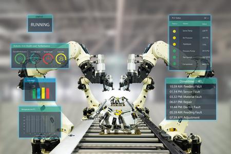 conceito iot indústria 4.0. Fábrica inteligente usando braços robóticos de automação com tecnologia de realidade virtual mista aumentada para mostrar dados com interface de usuário de inteligência artificial (ui) enquanto linha de operação Foto de archivo