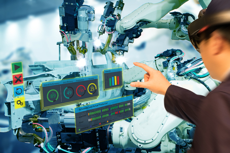iot industry 4.0 concept,industrial engineer(blurred) using smart glasses with augmented mixed with virtual reality technology to monitoring machine in real time.Smart factory use Automation robot arm Stockfoto