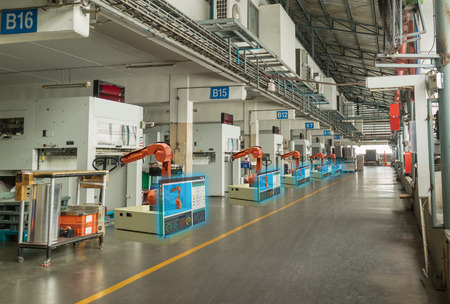 iot smart industry 4.0 concept. Automation industrial robotic arm working in operation machine zone in factory and Robot show data oee, plc status by using augmented mixed virtual reality technololgy