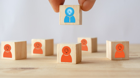 hand put ,pick or choose the one who got idea or special or right man for job than other in human resources management (hrm) or recruitment in business concept Stock Photo