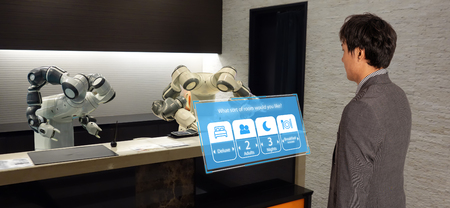 smart hotel in hospitality industry 4.0  concept, the receptionist robot (robot assistant ) in lobby of hotel or airports always welcome customer the service is  including room, information provision