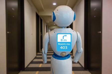 smart hotel in hospitality industry 4.0 technology concept, robot butler (robot assistant) use for greet arriving guests, deliver customer, items to rooms, give information, support  variety languages