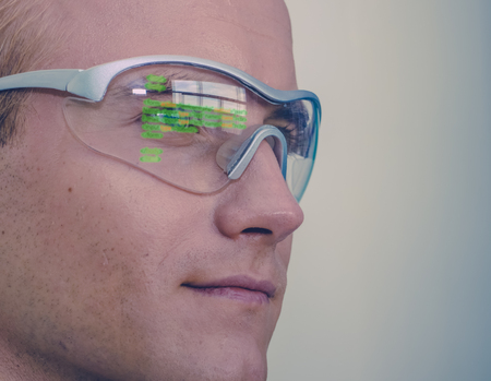 smart glasses futuristic technology concept, man wear smart glasses with augmented reality to Managing field service and assembly, in warehouse as addition to voice, Navigation and map in industry 4.0