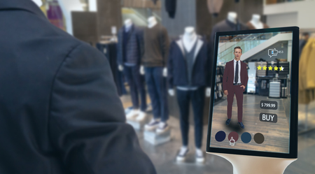 iot smart retail futuristic technology concept, happy man try to use smart display with virtual or augmented reality  in the shop or retail to choose select ,buy cloths and give a rating of products Standard-Bild