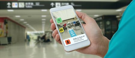 smart technology in industry mobile 4.0 or 5.0 concept , user use mobile phone with augmented mixed virtual reality technology in real 3d for show the map,shop,  and walk way path to gate in airport