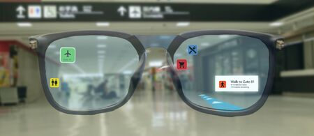smart technology in industry mobile 4.0 or 5.0 concept , user use smart glasses with augmented mixed virtual reality technology in real 3d for show the map,shop,  and walk way path to gate in airport Фото со стока