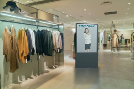 iot smart retail futuristic technology concept, smart Digital Signage display with virtual or augmented reality in the shop or retail advice to choose select ,buy cloths and give a rating of products Фото со стока