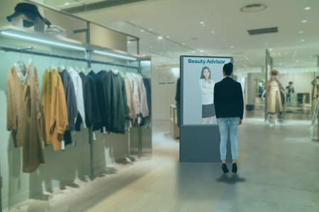iot smart retail futuristic technology concept, smart Digital Signage display with virtual or augmented reality in the shop or retail advice to choose select ,buy cloths and give a rating of products 版權商用圖片