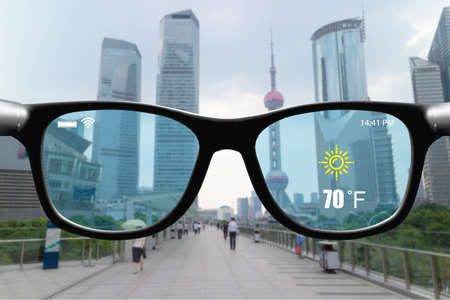 Futuristic technology trend concept in smart glasses.business man can get experience with use smart glasses which has augmented reality while work travel play Banco de Imagens